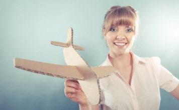 Lady holding plane image