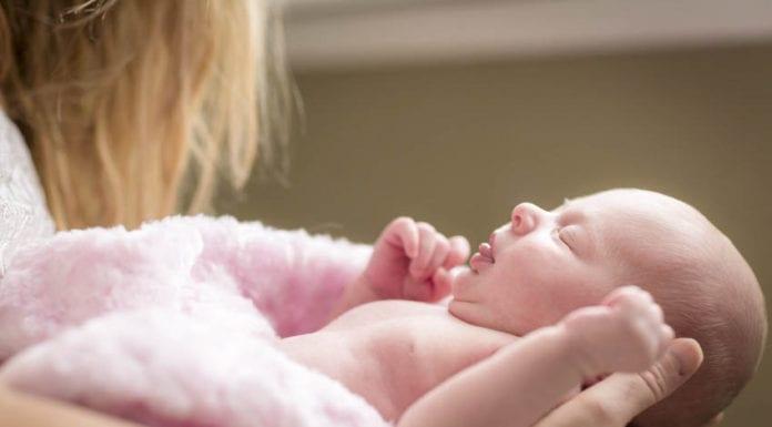 Mother Holding Newborn Image