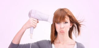 Sad Lady With Hair Dryer Image
