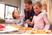 family making pizza image