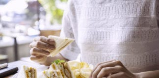 Woman Eating a Sandwich Image