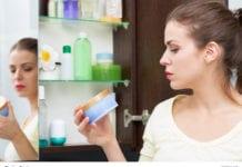 Woman Looking At Makeup Image
