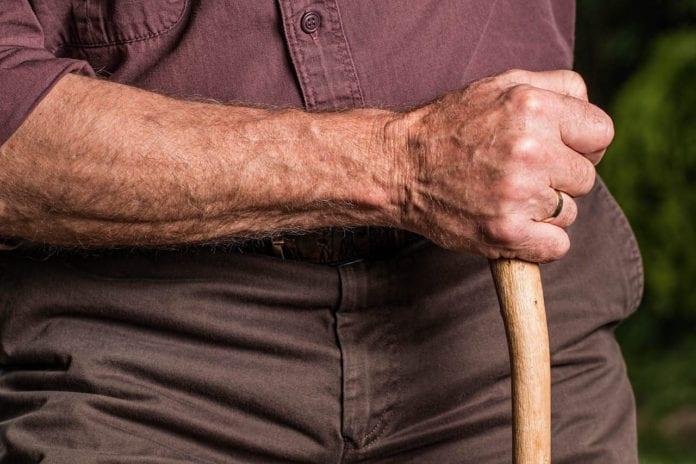 Man Holding Cane Image