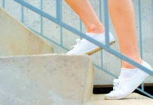 """Close-up of white shoes climbing stairs"""""