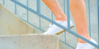 """""""Close-up of white shoes climbing stairs"""""""""""