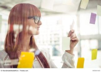 Woman Looking At Notes Image