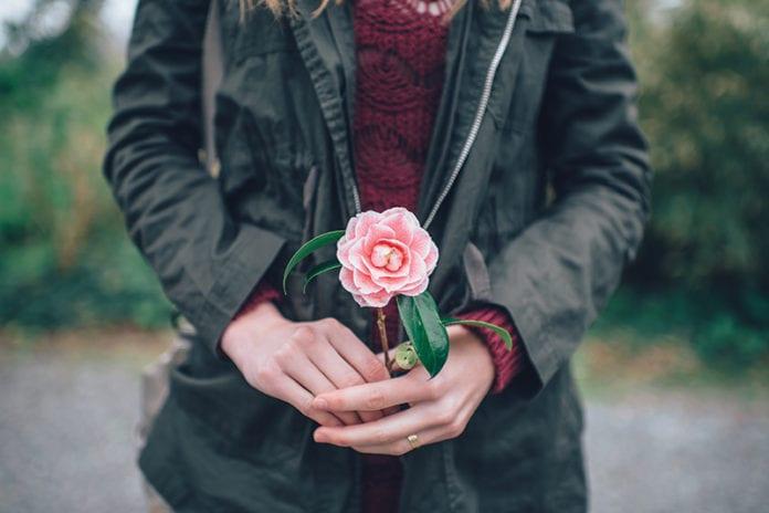 Girl Holding Flower Image