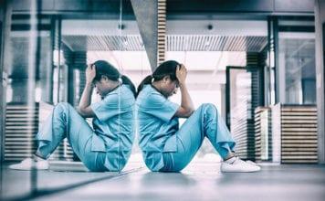 """""""Upset female nurse sitting on the floor"""""""