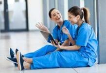 Two female nurses in blue scrubs