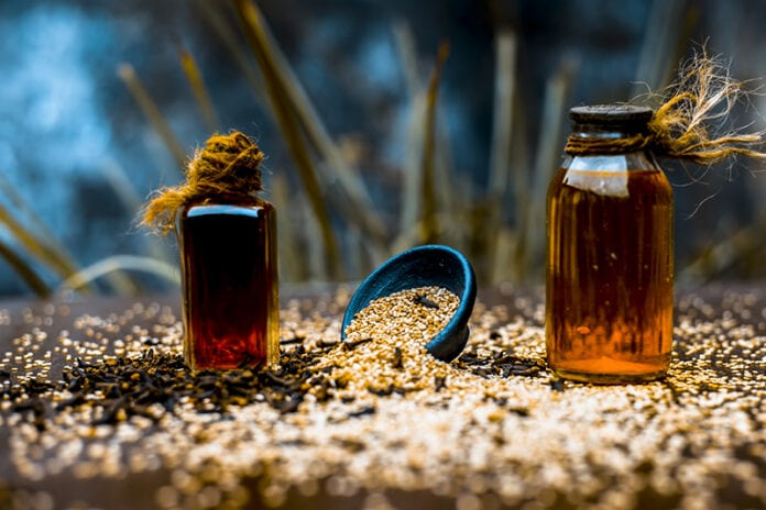 Two home made remedies surrounded by a pile of grains