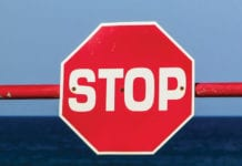 """Stop sign on blue background"""
