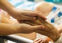 Nurse_Holding_Hand_Image
