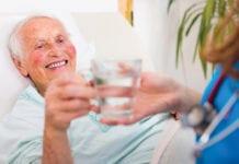 """""""Elderly patient grabbing water"""""""