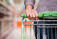 """Close-up of woman's hands pushing cart"""