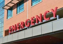 """Close-up of emergency sign on building"""