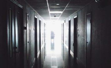 """Dark hospital hallway"""