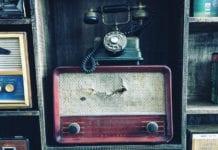 """Antique phone and radio player"""