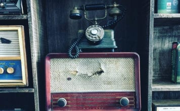 """Antique phone and radio player"""
