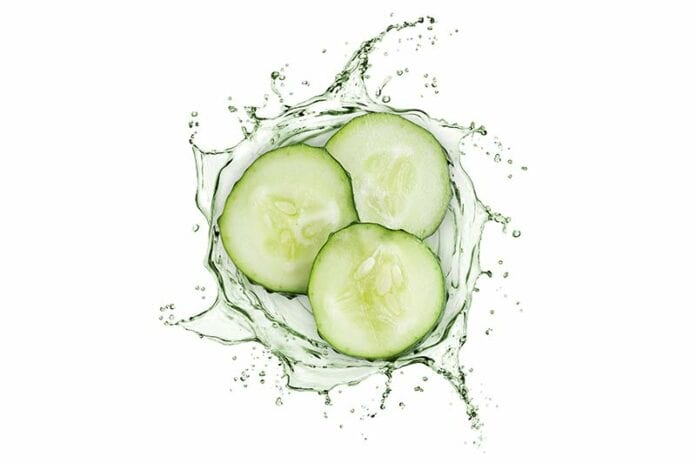Three slices of cucumber in a spiral of water to be used for puffy eyes