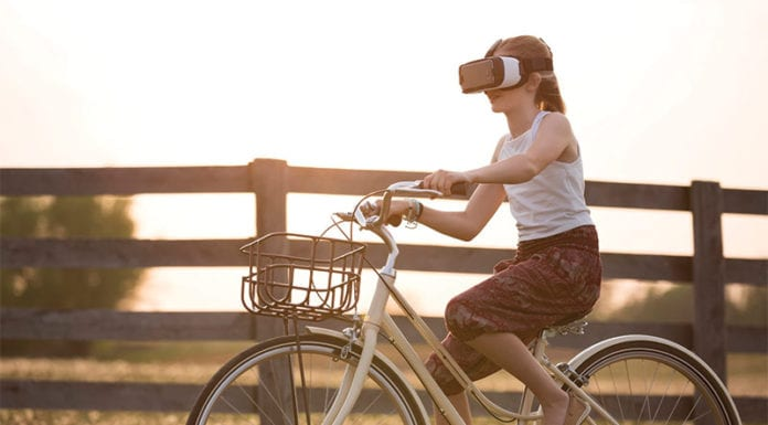 """""""Young girl riding bike with VR glasses"""""""