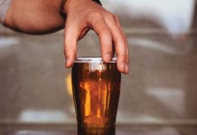 """Male hand grabbing a beer"""