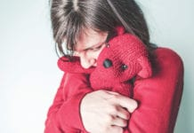 """Girl holding teddy bear"""
