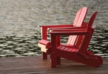 """""""Two red chairs by the lake"""""""