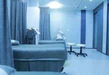 """Empty blue hospital room"""