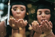 """Two graduating girls"""