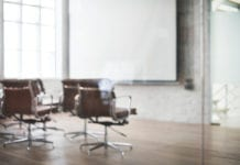 """Blurred image of boardroom"""
