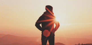 """Sun glaring behind person"""