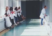 """""""Line of nurses in hospital hallway"""""""