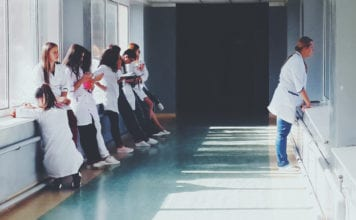 """Line of nurses in hospital hallway"""
