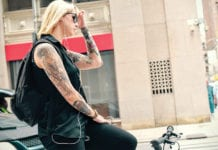 Woman on bike with lots of tattoos""