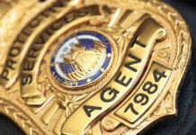 """Close-up of cop badge"""