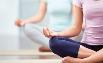 """Two women doing yoga"""