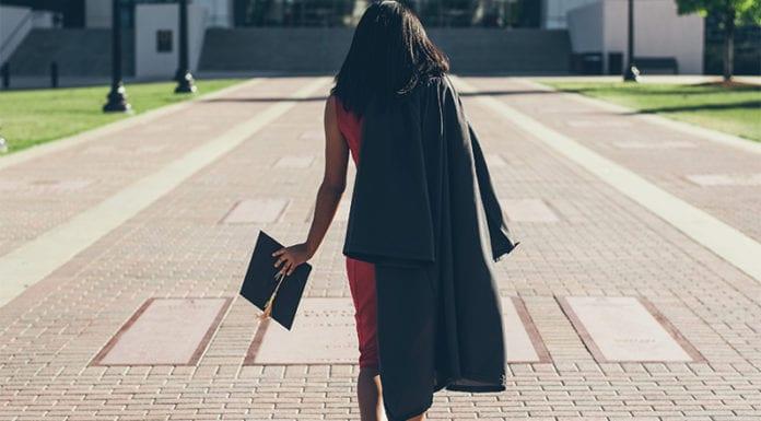 """Girl graduating""Photo by Jonathan Daniels on Unsplash"