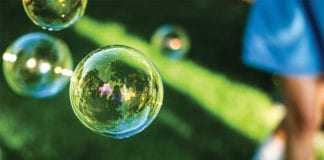"""Kid making bubbles"""