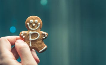 """""""Hand holding gingerbread cookie"""""""
