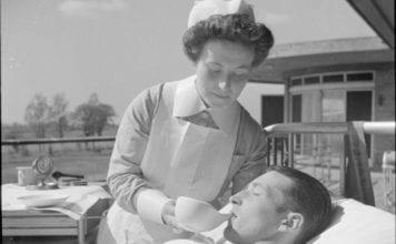 """Female nurse giving trooper water"""