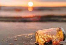 """Jar with lights on the beach"""