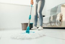 Nurse mopping the floor during spring cleaning