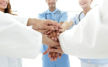 """Medical team hand pile"""