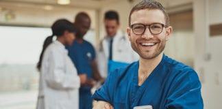 """Smiling male nurse"""