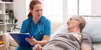 Female nurse talking with older patient